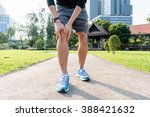 male runner knee injury and pain | Shutterstock . vector #388421632