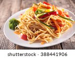 fried noodles and vegetables | Shutterstock . vector #388441906