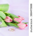Two Rings And Tulips On A Pink...