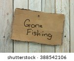 Cardboard Sign On A Wooden...