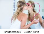 woman kissing the mirror in the ... | Shutterstock . vector #388544845