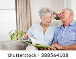 senior couple sitting on sofa...   Shutterstock . vector #388564108