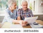 worried senior couple checking... | Shutterstock . vector #388566886