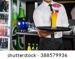 mid section of bartender... | Shutterstock . vector #388579936
