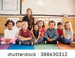 teacher and elementary school... | Shutterstock . vector #388630312