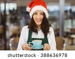 Woman With Santa Hat Holding...