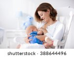 young mother holding her... | Shutterstock . vector #388644496