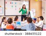 teacher at the front of class... | Shutterstock . vector #388655122