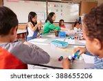 elementary school teacher uses... | Shutterstock . vector #388655206