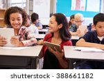 teacher among kids with... | Shutterstock . vector #388661182