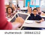 teacher using tablet computer... | Shutterstock . vector #388661212