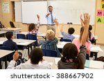 kids raising hands to answer in ... | Shutterstock . vector #388667902