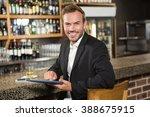 handsome man using tablet... | Shutterstock . vector #388675915