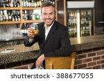 handsome man having a whiskey... | Shutterstock . vector #388677055