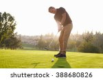 male golfer putting ball into... | Shutterstock . vector #388680826