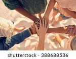 group of young men and women... | Shutterstock . vector #388688536