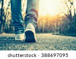 woman jeans and sneaker shoes | Shutterstock . vector #388697095