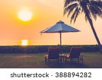 empty umbrella and chair on the ... | Shutterstock . vector #388894282