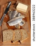 Small photo of Making sandwiches with pickled herring and butter. Salted, soused skinless fillets of fish Clupea.