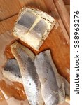 Small photo of Sandwich with pickled herring and butter. Salted, soused skinless fillets of fish Clupea.