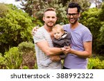 Smiling Gay Couple With Child...