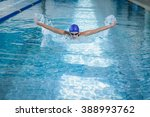 fit woman swimming in the pool | Shutterstock . vector #388993762