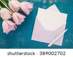 flowers  envelope and pen on a...   Shutterstock . vector #389002702