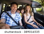 smiling family sitting in the... | Shutterstock . vector #389016535