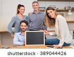 happy businesspeople in office... | Shutterstock . vector #389044426