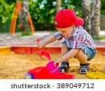 child plays with sand  | Shutterstock . vector #389049712