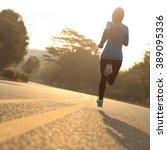 young fitness woman runner...   Shutterstock . vector #389095336