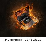 laptop burning with fire | Shutterstock . vector #389113126