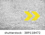 arrow sign on white brick wall | Shutterstock . vector #389118472