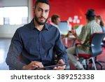 confident male designer working ... | Shutterstock . vector #389252338