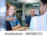 unposed group of creative... | Shutterstock . vector #389280172