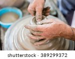 clay potter creating on the... | Shutterstock . vector #389299372