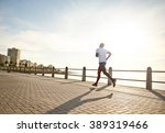 young black man running on the... | Shutterstock . vector #389319466