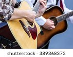 female hands playing acoustic... | Shutterstock . vector #389368372