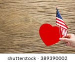 Hand Holding Red Paper Heart...