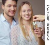 estate agent handing over a set ... | Shutterstock . vector #389437975