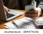 man doing on line banking and... | Shutterstock . vector #389474146