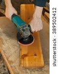 grinder on the job in hands   Shutterstock . vector #389502412
