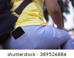 smart phone in pocket of girl's ... | Shutterstock . vector #389526886