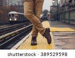 closeup of  man wearing boots... | Shutterstock . vector #389529598