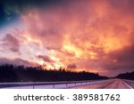 autobahn at sunset with... | Shutterstock . vector #389581762