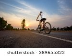 bike on road to the sunset | Shutterstock . vector #389655322