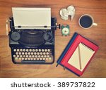 vintage typewriter. cup  pencil ...   Shutterstock . vector #389737822