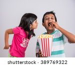 indian cute girl and boy eating ...   Shutterstock . vector #389769322