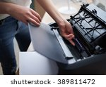 replacement of the cartridge in ... | Shutterstock . vector #389811472