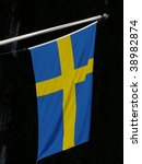 swedish flag isolated over black background - stock photo